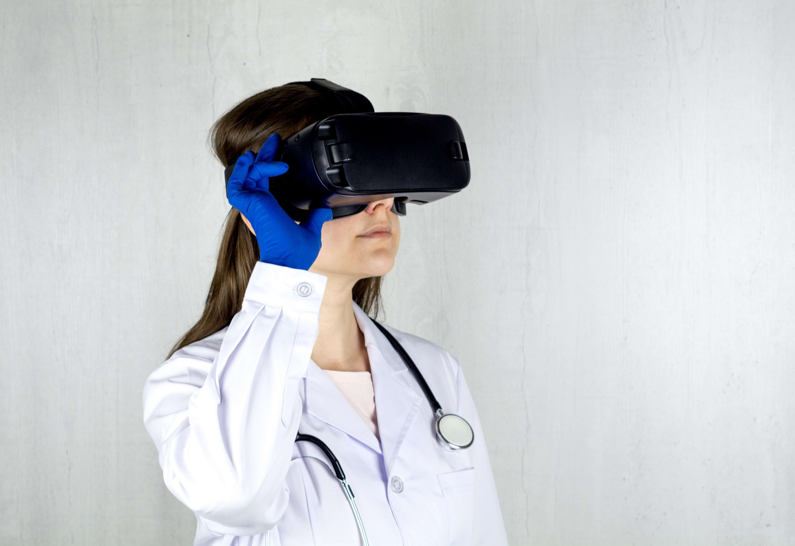 doctor wearing virtual reality therapy headset